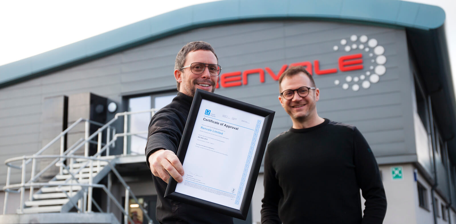 CEO stephen james and Anthony Moss with the ISO 9001 certificate