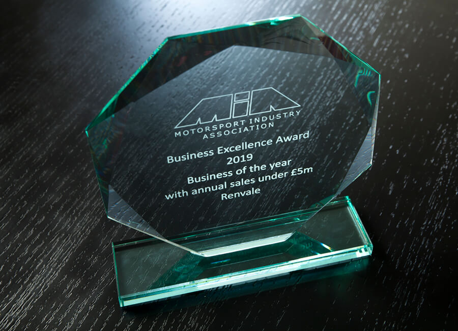 MIA Business Excellence Award on dark wood table